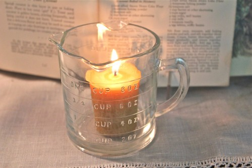 votive candle in a measuring cup